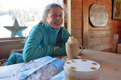 Enjoying hot chocolate at Chalet Montsoleil Claviere in Italy