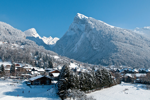 The stunning setting of Samoens surrounded by snow-capped peaks. Image credit: Samoëns - Christian Martelet